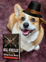 Getting ready for turkey! A good book is a must this weekend for Corgis.